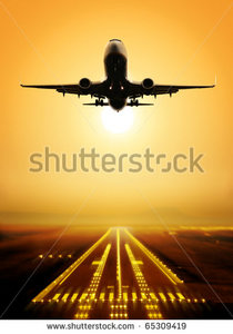 stock-photo-passenger-plane-fly-up-over-take-off-runway-from-airport-at-sunset-65309419.jpg