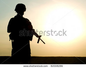 stock-photo-silhouette-of-us-soldier-with-rifle-against-a-sunset-82008286.jpg
